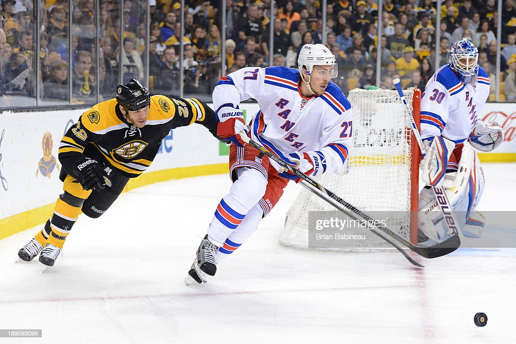 Ryan McDonagh #27 of the New York Rangers skates with the puck against Shawn Thornton #22 of the Boston Bruins in Game Five of the Eastern Conference Semifinals during the 2013 NHL Stanley Cup Playoffs at TD Garden on May 25, 2013 in Boston, Massachusetts.