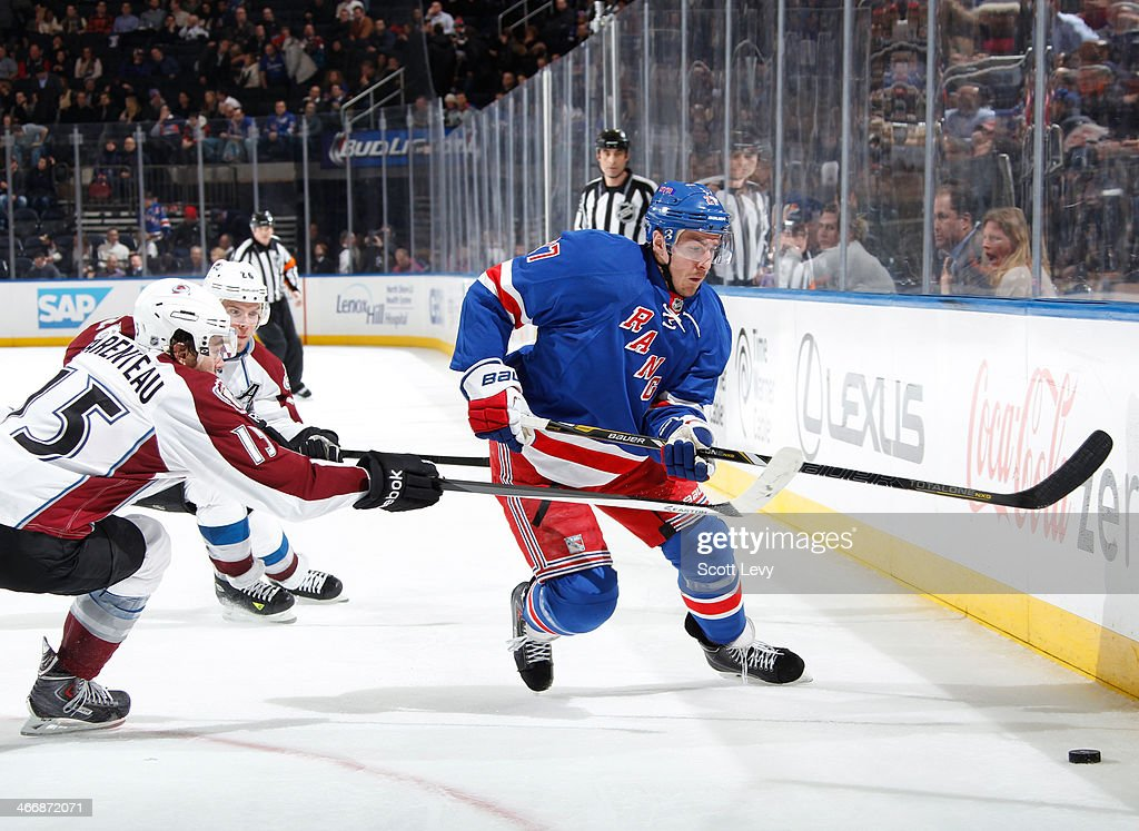 <a gi-track='captionPersonalityLinkClicked' href=/galleries/search?phrase=Ryan+McDonagh&family=editorial&specificpeople=4324983 ng-click='$event.stopPropagation()'>Ryan McDonagh</a> #27 of the New York Rangers skates with the puck against the Colorado Avalanche at Madison Square Garden on February 4, 2014 in New York City.