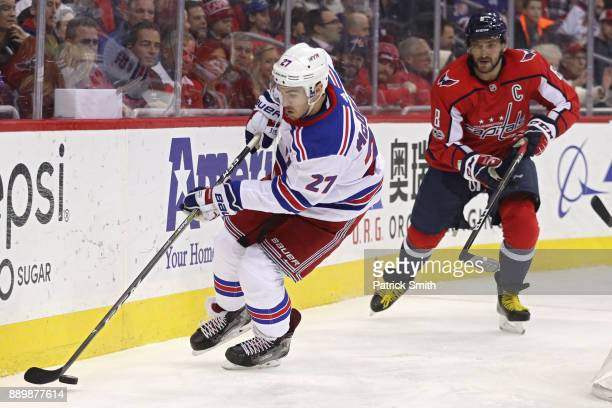 Ryan McDonagh of the New York Rangers skates with the puck past Alex Ovechkin of the Washington Capitals during the second period at Capital One...
