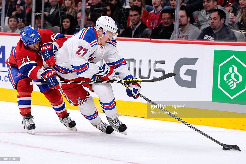 Ryan McDonagh #27 of the New York Rangers skates with the puck while being chased by Brian Gionta #21 of the Montreal Canadiens during the NHL game at the Bell Centre on March 30, 2013 in Montreal, Quebec, Canada.