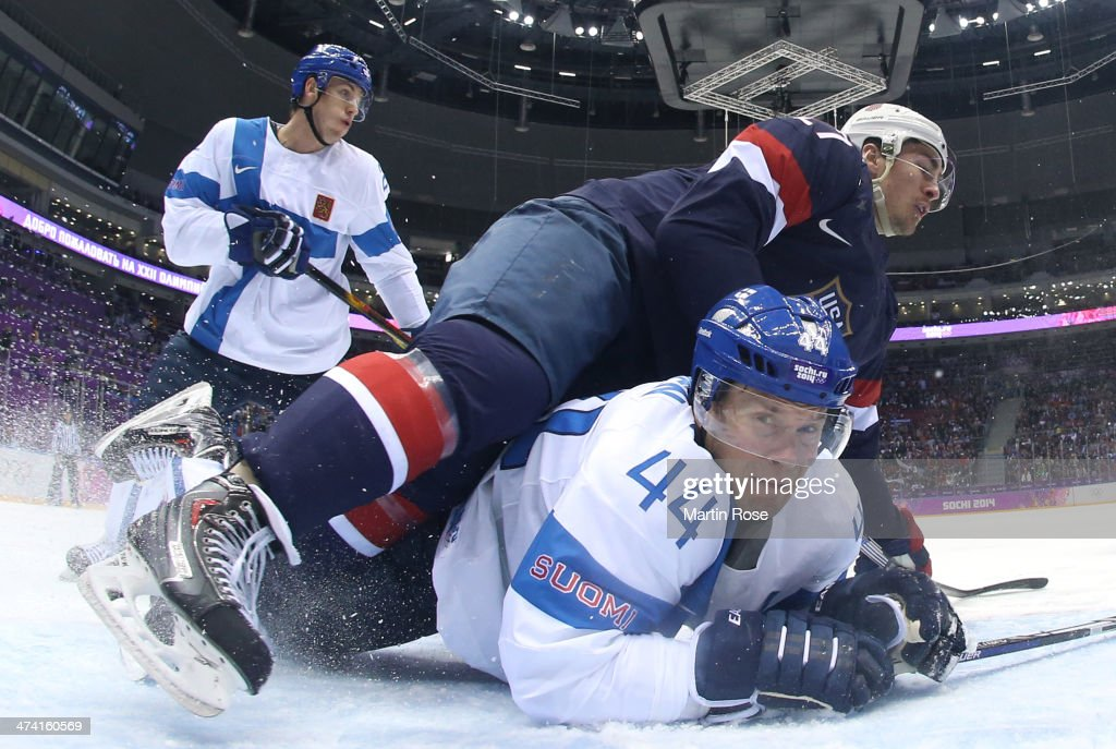 Ryan McDonagh #27 of the United States falls on Kimmo Timonen #44 of Finland in the first period during the Men's Ice Hockey Bronze Medal Game on Day 15 of the 2014 Sochi Winter Olympics at Bolshoy Ice Dome on February 22, 2014 in Sochi, Russia.