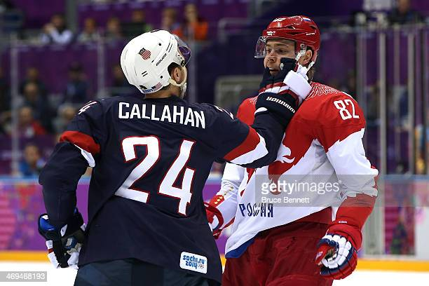 Ryan McDonagh of United States pushes Evgeny Medvedev of Russia during the Men's Ice Hockey Preliminary Round Group A game on day eight of the Sochi...