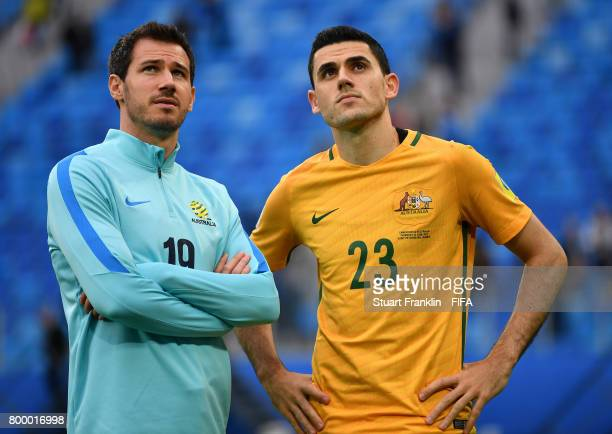 Ryan McGowan and Tomas Rogic of Autralia look on after the FIFA Confederation Cup Group B match between Cameroon and Australia at Saint Petersburg...