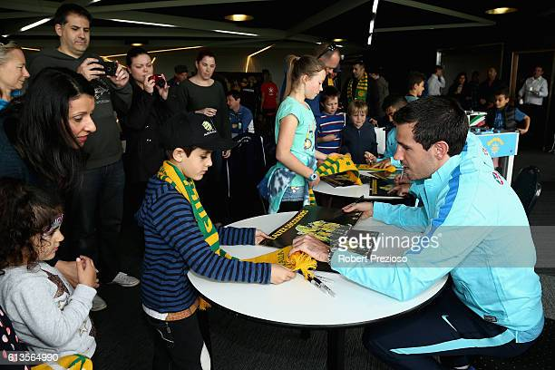 Ryan McGowan signs autographs during a coaching clinic during the Caltex Socceroos Fan Day at North Port Oval on October 9 2016 in Melbourne Australia