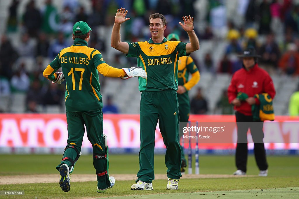 <a gi-track='captionPersonalityLinkClicked' href=/galleries/search?phrase=Ryan+McLaren&family=editorial&specificpeople=2227619 ng-click='$event.stopPropagation()'>Ryan McLaren</a> (C) of South Africa celebrates with AB de Villiers (L) aftertaking the last wicket of Junaid Khan of Pakistan during the ICC Champions Trophy Group B match between Pakistan and South Africa at Edgbaston on June 10, 2013 in Birmingham, England.