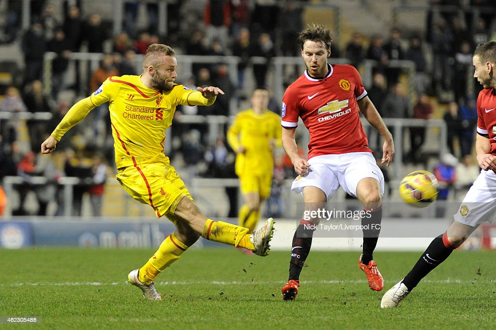 Ryan McLaughlin of Liverpool and Nick Powell of Manchester United in action during the Barclays U21 Premier League match between Manchester United and Liverpool at Leigh Sports Village on January 26, 2015 in Leigh, Greater Manchester.