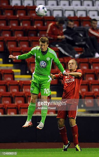 Ryan McLaughlin of Liverpool goes up with Maximilian Arnold of Wolfsburg during the NextGen Series Group 2 match between Liverpool U19 and VfL...
