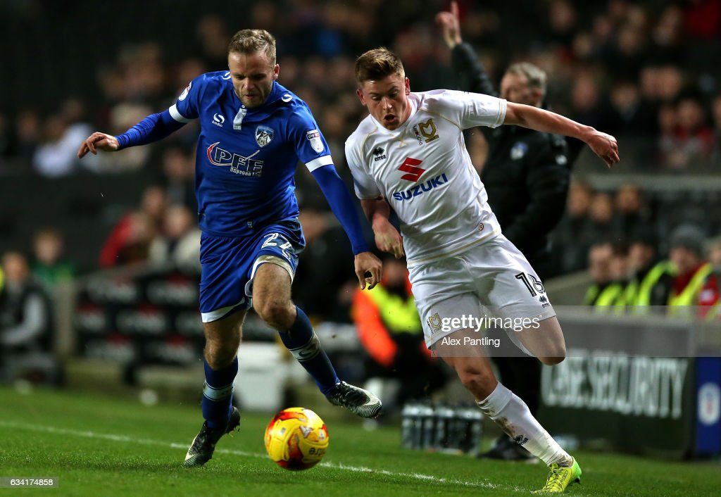 Ryan McLaughlin of Oldham Athletic pulls back Harvey Barnes of MK Dons during the Sky Bet League One match between Milton Keynes Dons and Oldham Athletic at StadiumMK on February 7, 2017 in Milton Keynes, England.