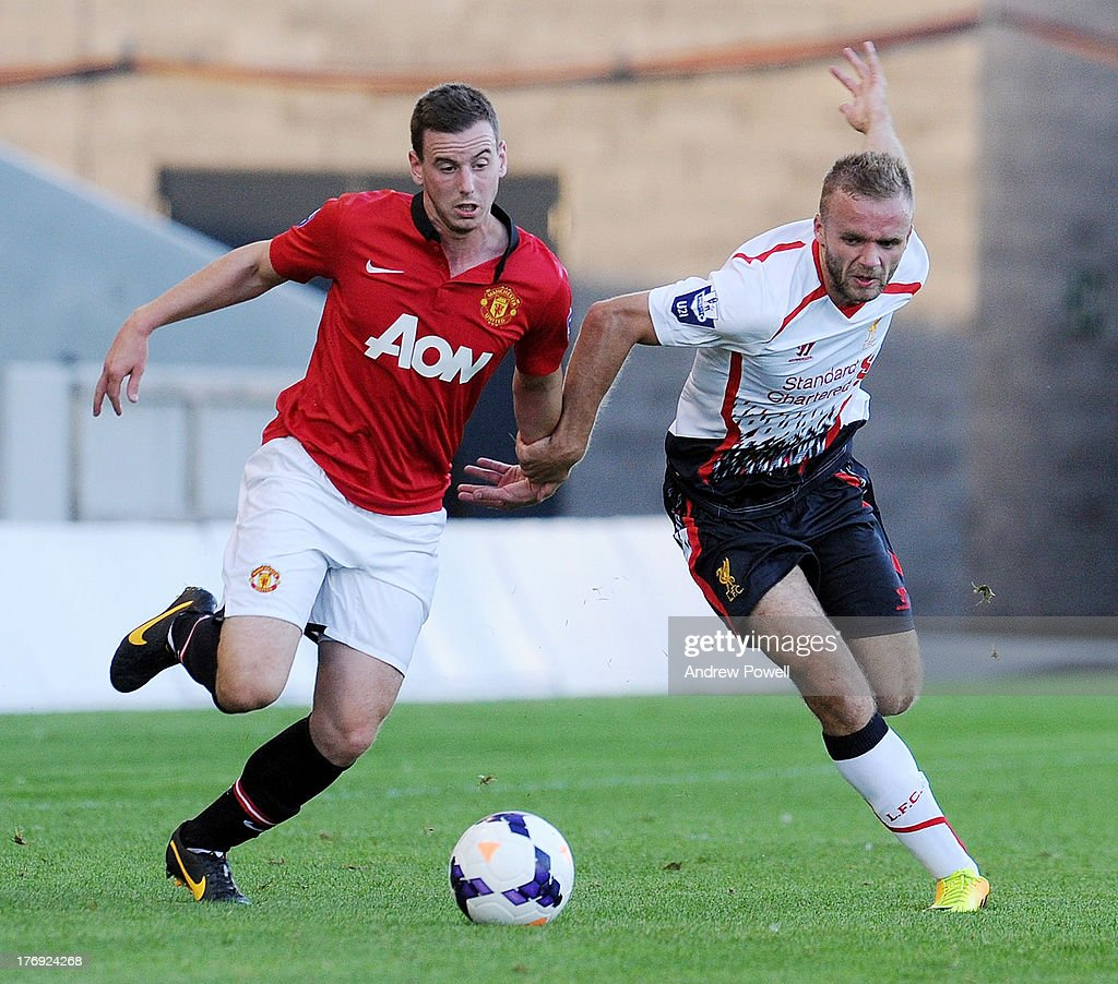 Ryan McLaughun of Liverpool competes with Marnick Vermijl of Manchester United during the Barclays U21s Premier League match between Manchester United U21 and Liverpool U21 at Salford City Stadium on August 19, 2013 in Salford, England.