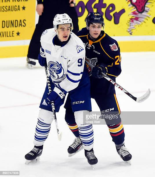 Ryan McLeod of the Mississauga Steelheads battles with Tyler MacArthur of the Barrie Colts during OHL game action on December 8 2017 at Hershey...