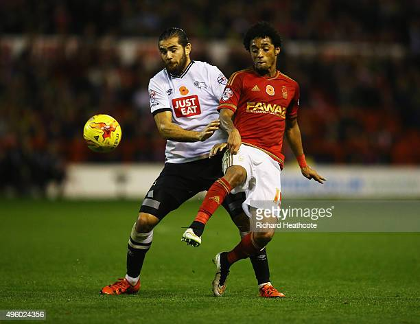 Ryan Mendes of Nottingham Forest battles with Bradley Johnson of Derby County during the Sky Bet Championship match between Nottingham Forest and...