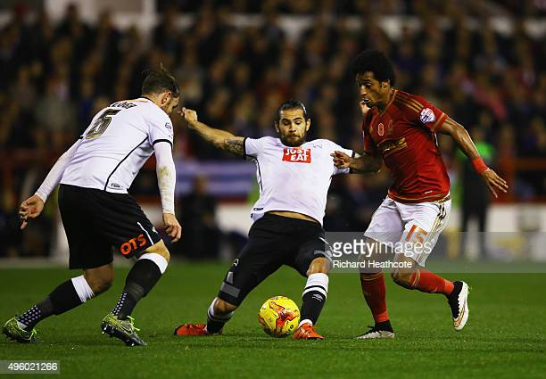 Ryan Mendes of Nottingham Forest takes on Richard Keogh and Bradley Johnson of Derby County during the Sky Bet Championship match between Nottingham...
