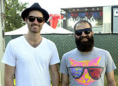 Ryan Merchant and Sebu Simonian of Capital Cities pose at the 2014 Bonnaroo Music Arts Festival on June 15 2014 in Manchester Tennessee
