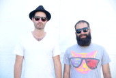 Ryan Merchant and Sebu Simonian of Capital Cities pose backstage during the 2014 Bonnaroo Music Arts Festival on June 15 2014 in Manchester Tennessee