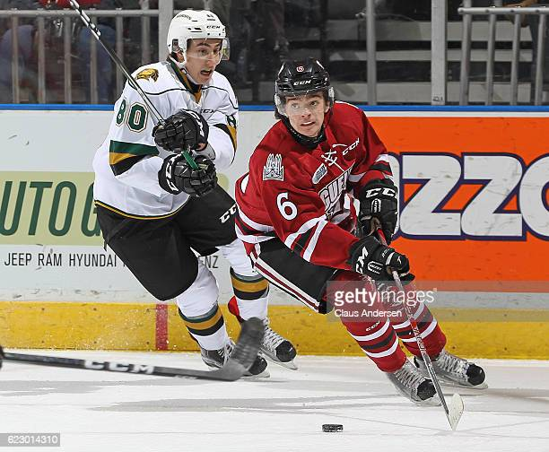 Ryan Merkley of the Guelph Storm skates away from a checking Alex Formenton of the London Knights during an OHL game at Budweiser Gardens on November...