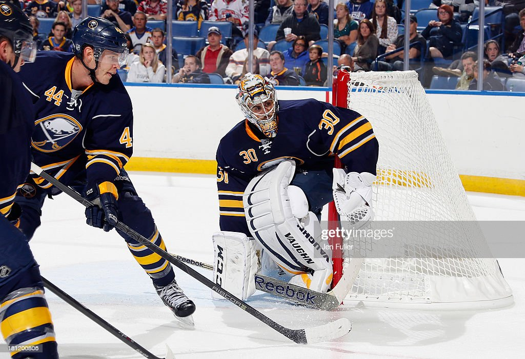 Ryan Miller #30 and <a gi-track='captionPersonalityLinkClicked' href=/galleries/search?phrase=Brayden+McNabb&family=editorial&specificpeople=4779653 ng-click='$event.stopPropagation()'>Brayden McNabb</a> #44 of the Buffalo Sabres protect the net against the Carolina Hurricanes at First Niagara Center on September 19, 2013 in Buffalo, United States.
