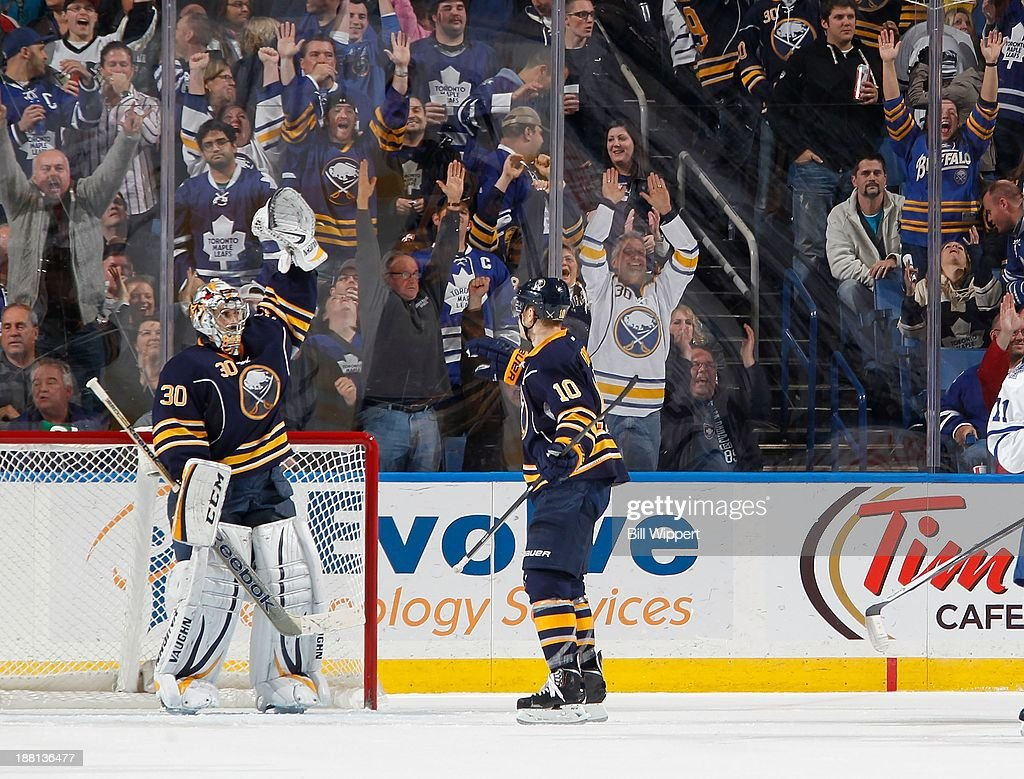 Ryan Miller #30 and <a gi-track='captionPersonalityLinkClicked' href=/galleries/search?phrase=Christian+Ehrhoff&family=editorial&specificpeople=214788 ng-click='$event.stopPropagation()'>Christian Ehrhoff</a> #10 of the Buffalo Sabres celebrate their 3-1 victory over the Toronto Maple Leafs on November 15, 2013 at the First Niagara Center in Buffalo, New York.