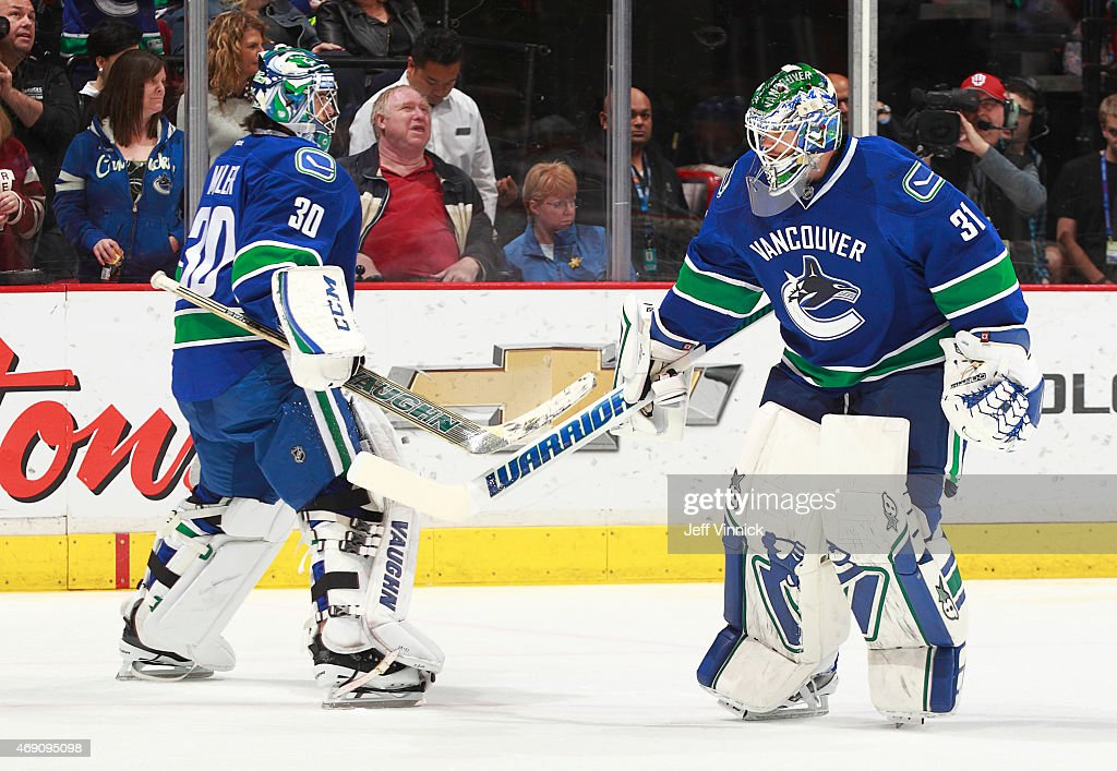 Ryan Miller #30 and Eddie Lack #31 of the Vancouver Canucks warm up for their NHL game against the Phoenix Coyotes at Rogers Arena April 9, 2015 in Vancouver, British Columbia, Canada.