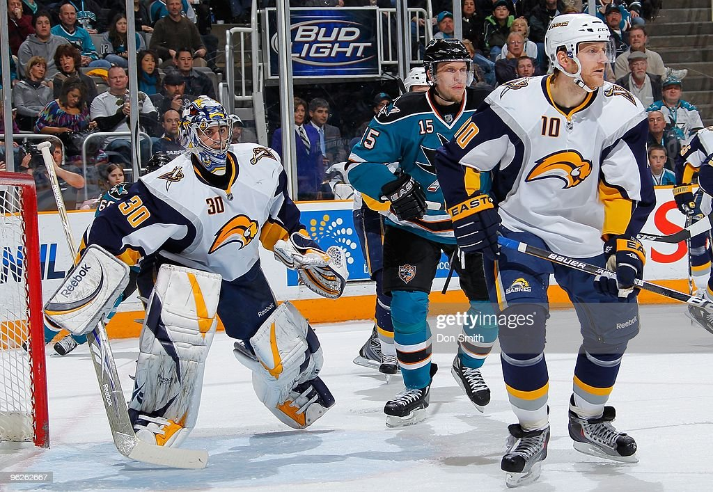 Ryan Miller #30 and Henrik Tallinder #10 of the Buffalo Sabres watch the puck while Dany Heatley #15 of the San Jose Sharks tries to post up by the net during an NHL game on January 23, 2010 at HP Pavilion at San Jose in San Jose, California.