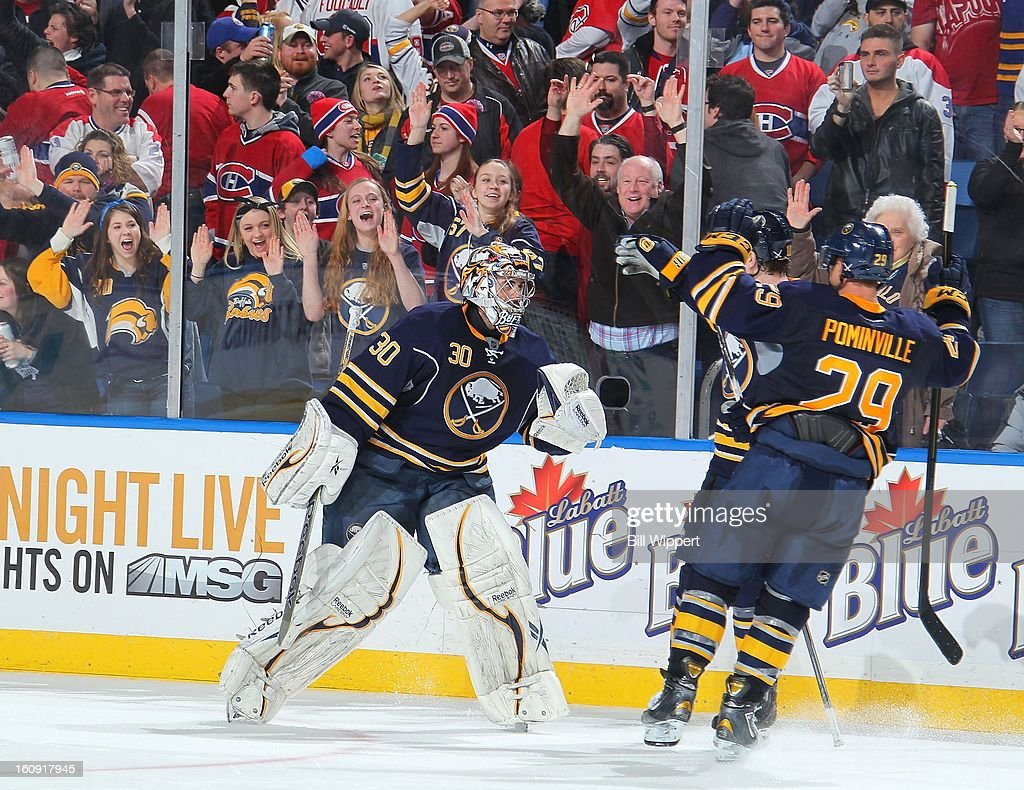 Ryan Miller #30 and <a gi-track='captionPersonalityLinkClicked' href=/galleries/search?phrase=Jason+Pominville&family=editorial&specificpeople=570525 ng-click='$event.stopPropagation()'>Jason Pominville</a> #29 of the Buffalo Sabres celebrate a 4-3 shootout victory over the Montreal Canadiens on February 7, 2013 at the First Niagara Center in Buffalo, New York.