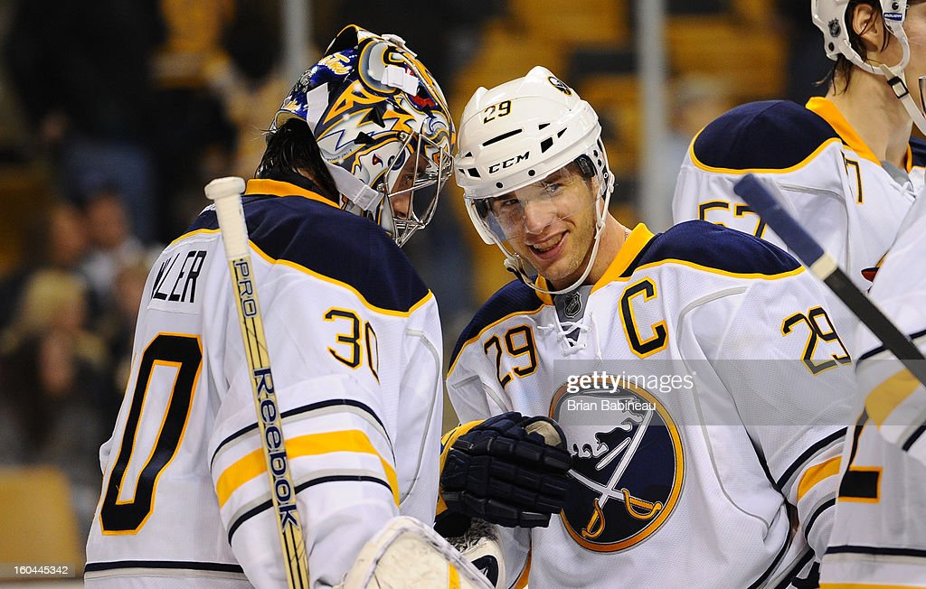 Ryan Miller #30 and <a gi-track='captionPersonalityLinkClicked' href=/galleries/search?phrase=Jason+Pominville&family=editorial&specificpeople=570525 ng-click='$event.stopPropagation()'>Jason Pominville</a> #29 of the Buffalo Sabres celebrate a win against the Boston Bruins at the TD Garden on January 31, 2013 in Boston, Massachusetts.