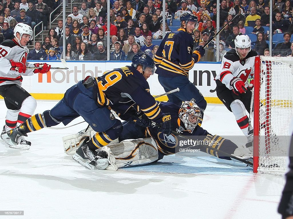 Ryan Miller #30 and Jason Pominville #29 of the Buffalo Sabres reach back in an attempt to stop a second period goal scored by <a gi-track='captionPersonalityLinkClicked' href=/galleries/search?phrase=Steve+Bernier&family=editorial&specificpeople=557040 ng-click='$event.stopPropagation()'>Steve Bernier</a> #18 of the New Jersey Devils on March 2, 2013 at the First Niagara Center in Buffalo, New York.
