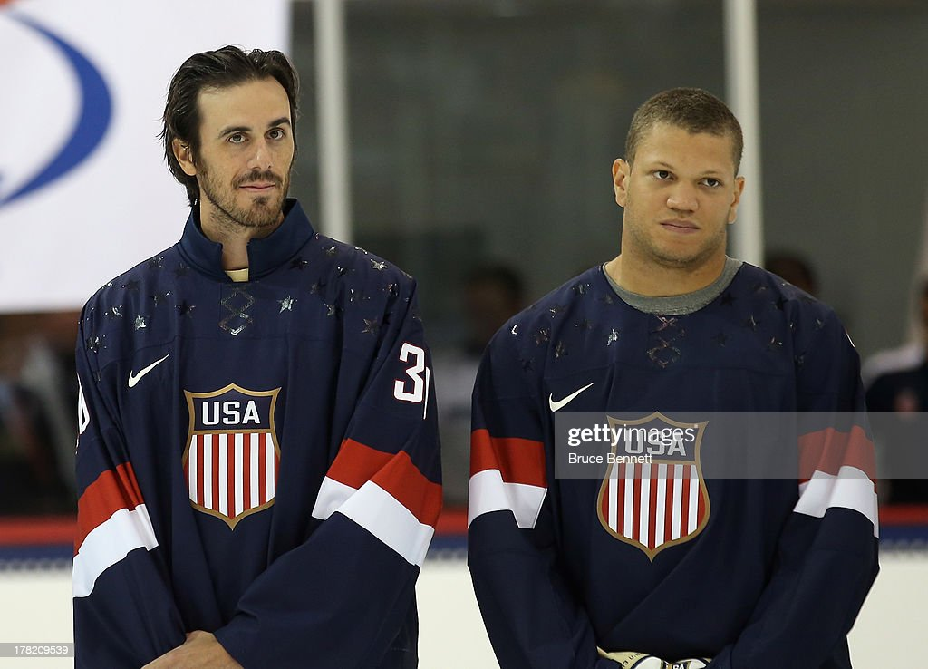 Ryan Miller and Kyle Okposo take part in a press conference introducing the 2014 USA Hockey Olympic Team candidates at the Kettler Capitals Iceplex on August 27, 2013 in Arlington, Virginia.
