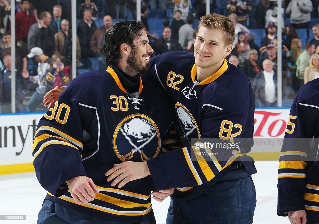 Ryan Miller #30 and Marcus Foligno #82 of the Buffalo Sabres share a moment following their final game of the season against the New York Islanders on April 26, 2013 at the First Niagara Center in Buffalo, New York.