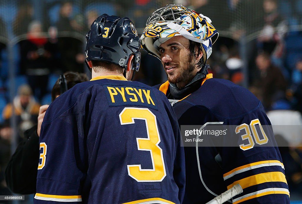 Ryan Miller #30 and <a gi-track='captionPersonalityLinkClicked' href=/galleries/search?phrase=Mark+Pysyk&family=editorial&specificpeople=6571526 ng-click='$event.stopPropagation()'>Mark Pysyk</a> #3 of the Buffalo Sabres celebrate a 2-1 victory over the Ottawa Senators at First Niagara Center on December 10, 2013 in Buffalo, New York.