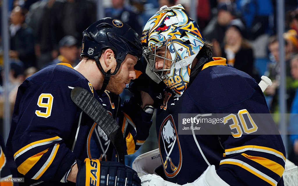 Ryan Miller #30 and <a gi-track='captionPersonalityLinkClicked' href=/galleries/search?phrase=Steve+Ott&family=editorial&specificpeople=210616 ng-click='$event.stopPropagation()'>Steve Ott</a> #9 of the Buffalo Sabres celebrate their 4-2 victory over the Winnipeg Jets at First Niagara Center on December 17, 2013 in Buffalo, New York.