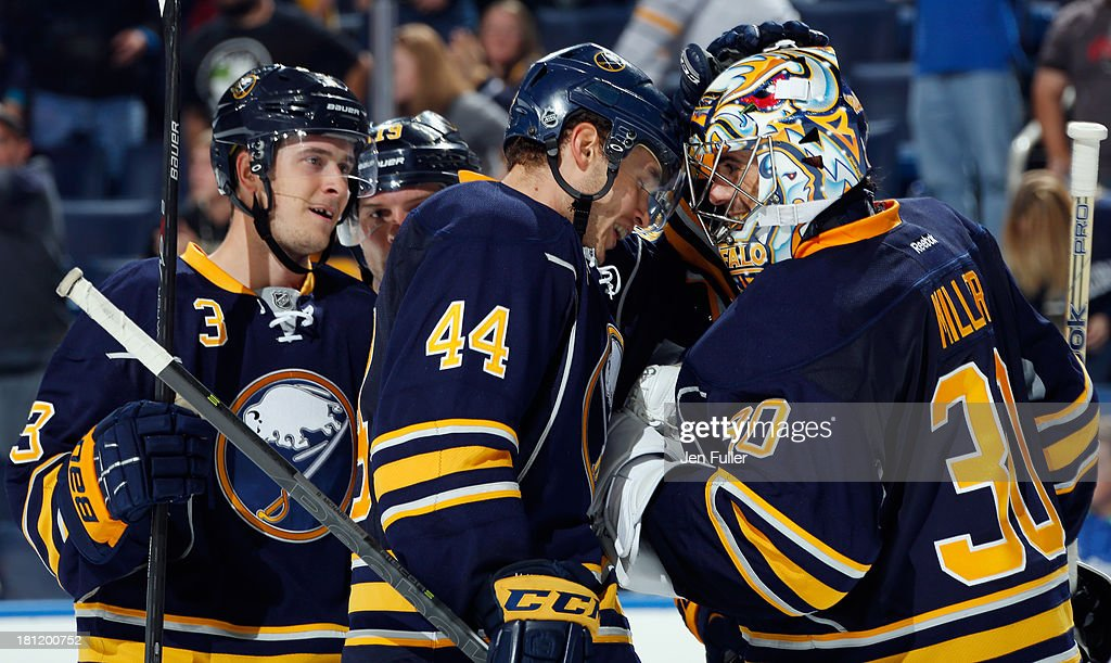 Ryan Miller #30, <a gi-track='captionPersonalityLinkClicked' href=/galleries/search?phrase=Brayden+McNabb&family=editorial&specificpeople=4779653 ng-click='$event.stopPropagation()'>Brayden McNabb</a> #44 and <a gi-track='captionPersonalityLinkClicked' href=/galleries/search?phrase=Mark+Pysyk&family=editorial&specificpeople=6571526 ng-click='$event.stopPropagation()'>Mark Pysyk</a> #3 of the Buffalo Sabres celebrate a 5-2 win against the Carolina Hurricanes at First Niagara Center on September 19, 2013 in Buffalo, United States.