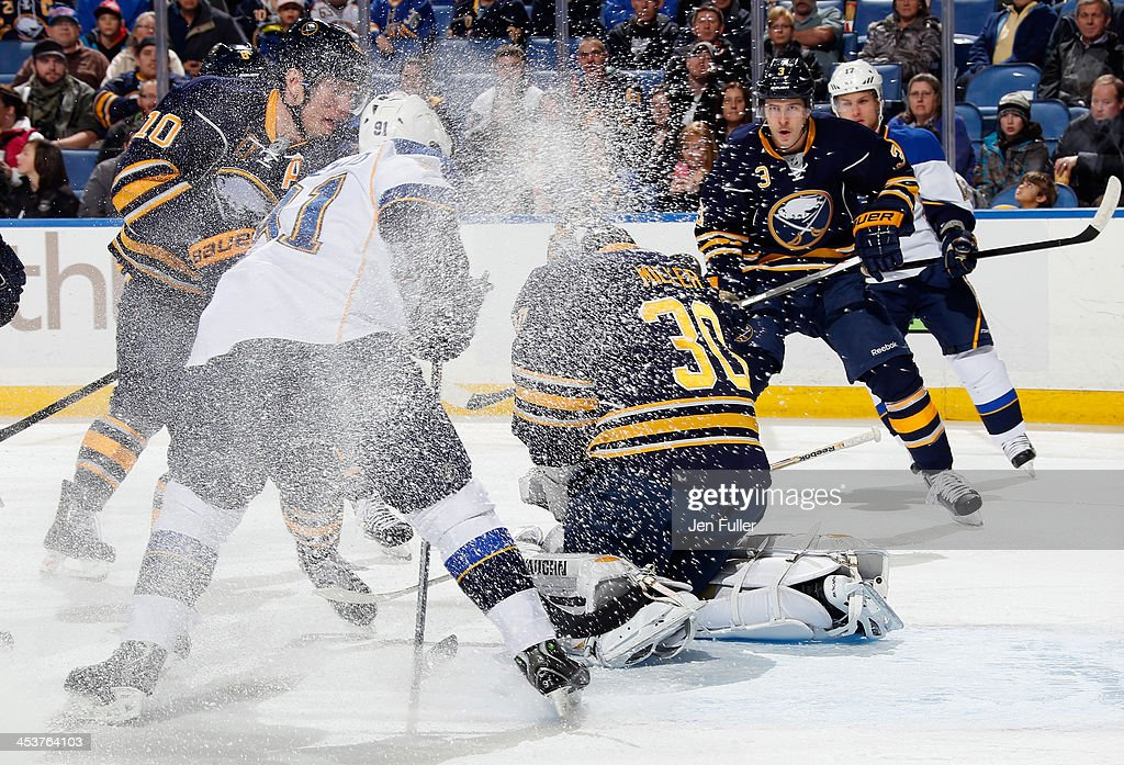 Ryan Miller #30, <a gi-track='captionPersonalityLinkClicked' href=/galleries/search?phrase=Christian+Ehrhoff&family=editorial&specificpeople=214788 ng-click='$event.stopPropagation()'>Christian Ehrhoff</a> #10 and <a gi-track='captionPersonalityLinkClicked' href=/galleries/search?phrase=Mark+Pysyk&family=editorial&specificpeople=6571526 ng-click='$event.stopPropagation()'>Mark Pysyk</a> #3 of the Buffalo Sabres guard the net as <a gi-track='captionPersonalityLinkClicked' href=/galleries/search?phrase=Vladimir+Tarasenko&family=editorial&specificpeople=6142635 ng-click='$event.stopPropagation()'>Vladimir Tarasenko</a> #91 of the St. Louis Blues looks for a rebound at First Niagara Center on November 19, 2013 in Buffalo, New York.