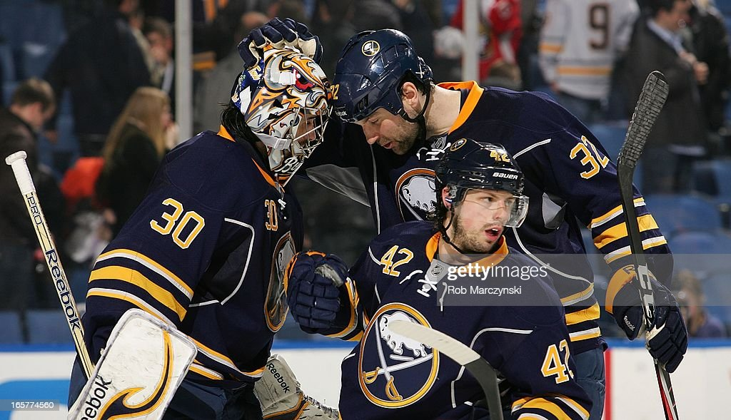 Ryan Miller #30, John Scott #32 and <a gi-track='captionPersonalityLinkClicked' href=/galleries/search?phrase=Nathan+Gerbe&family=editorial&specificpeople=697084 ng-click='$event.stopPropagation()'>Nathan Gerbe</a> #42 of the Buffalo Sabres celebrate their 4-2 victory against the Ottawa Senators on April 5, 2013 at the First Niagara Center in Buffalo, New York.