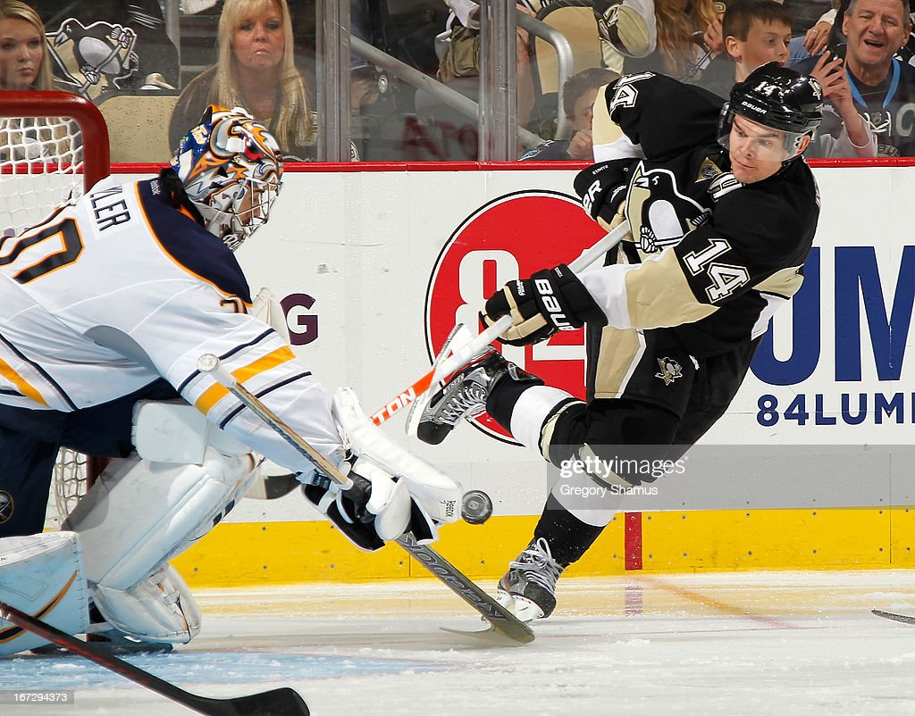 Ryan Miller #30 of the Buffalo Sabres blocks a shot by <a gi-track='captionPersonalityLinkClicked' href=/galleries/search?phrase=Chris+Kunitz&family=editorial&specificpeople=604159 ng-click='$event.stopPropagation()'>Chris Kunitz</a> #14 of the Pittsburgh Penguins on April 23, 2013 at Consol Energy Center in Pittsburgh, Pennsylvania. Buffalo won the game 4-2.