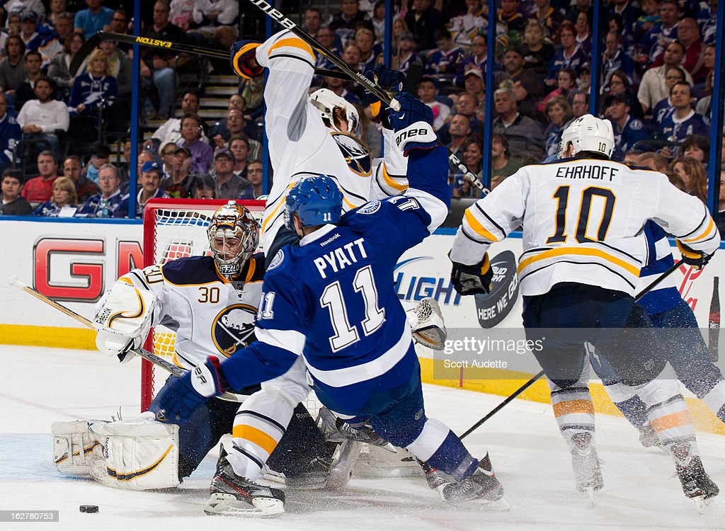 Ryan Miller #30 of the Buffalo Sabres blocks <a gi-track='captionPersonalityLinkClicked' href=/galleries/search?phrase=Tom+Pyatt&family=editorial&specificpeople=2079036 ng-click='$event.stopPropagation()'>Tom Pyatt</a> #11 of the Tampa Bay Lightning during the third period of the game at the Tampa Bay Times Forum on February 26, 2013 in Tampa, Florida.