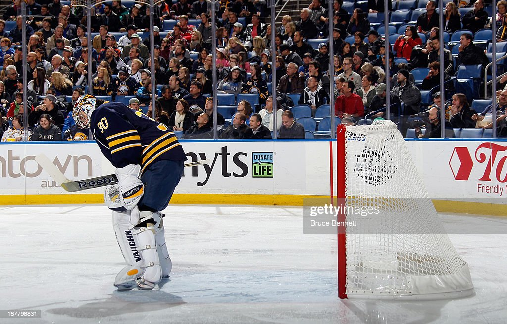 Ryan Miller #30 of the Buffalo Sabres bows his head after giving up a goal at 1:17 of the first period against the Los Angeles Kings at the First Niagara Center on November 12, 2013 in Buffalo, New York.