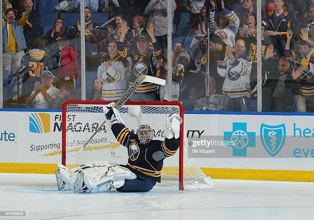 Ryan Miller #30 of the Buffalo Sabres celebrates his final save in the shootout of a 2-1 victory over the New York Islanders on April 26, 2013 at the First Niagara Center in Buffalo, New York. Miller played in his 500th career NHL game.
