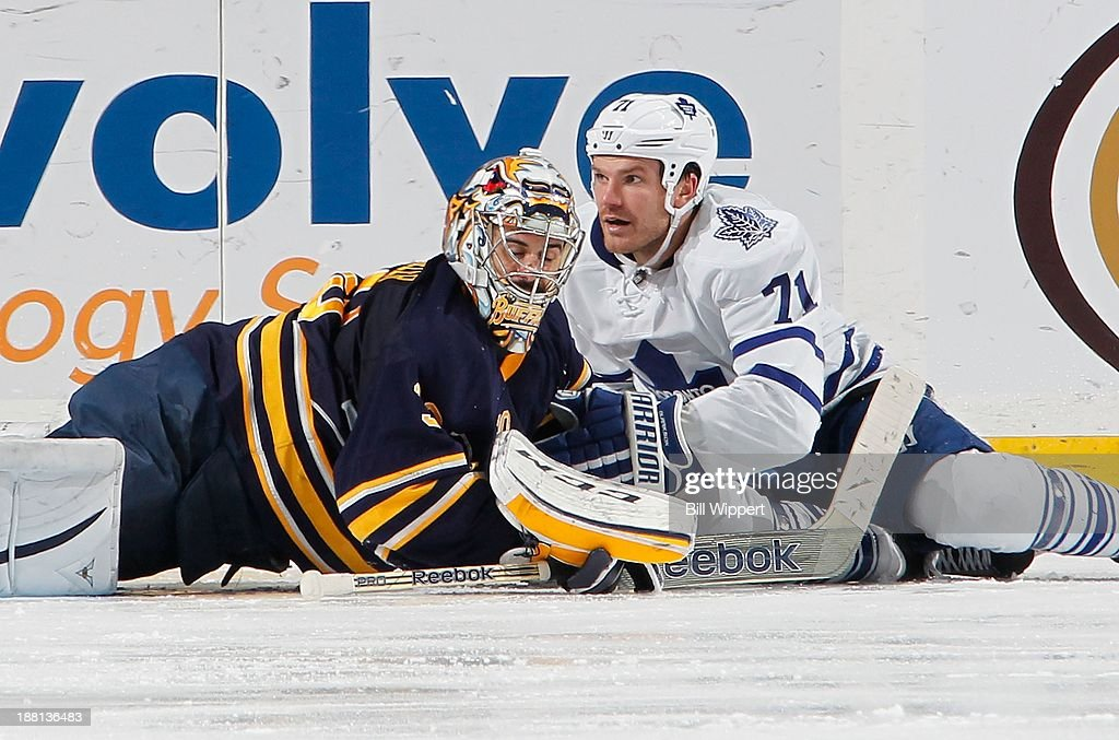 Ryan Miller #30 of the Buffalo Sabres collides with David Clarkson #71 of the Toronto Maple Leafs on November 15, 2013 at the First Niagara Center in Buffalo, New York. Buffalo won, 3-1.