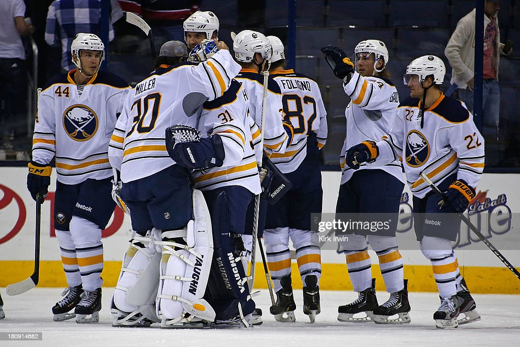 Ryan Miller #30 of the Buffalo Sabres congratulates <a gi-track='captionPersonalityLinkClicked' href=/galleries/search?phrase=Matt+Hackett&family=editorial&specificpeople=4161891 ng-click='$event.stopPropagation()'>Matt Hackett</a> #31 of the Buffalo Sabres after Buffalo defeated Columbus 3-1 on September, 2013 at Nationwide Arena in Columbus, Ohio.