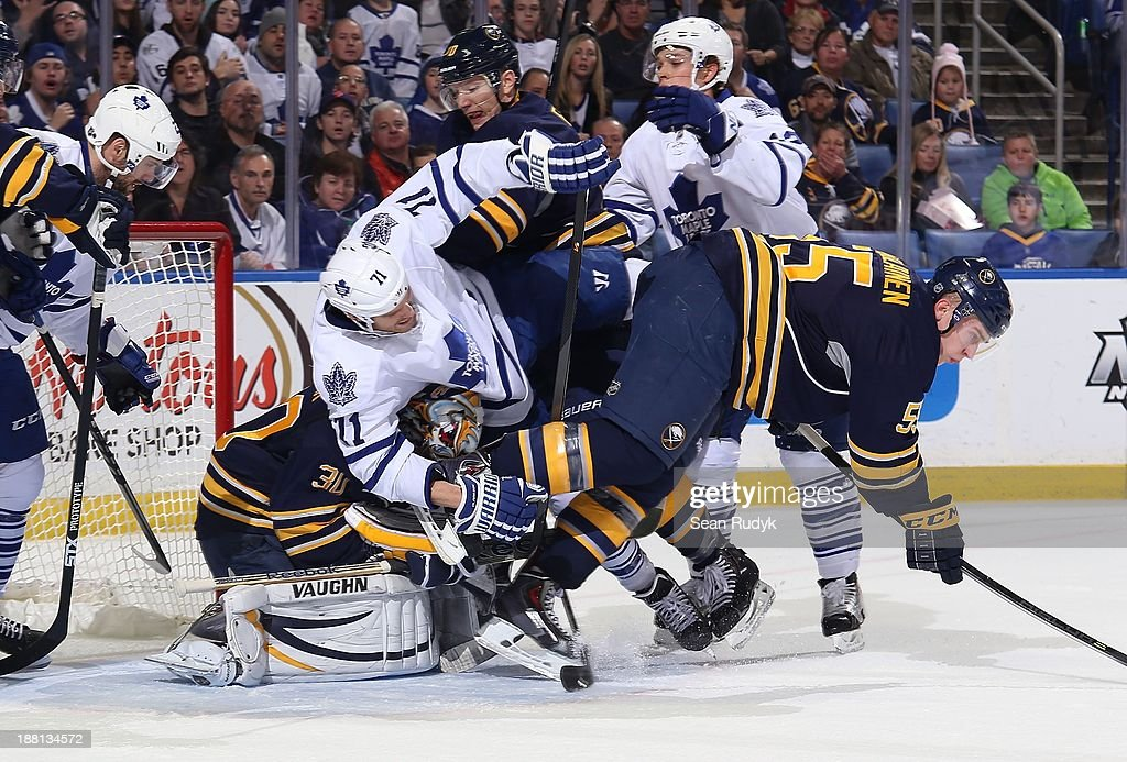 Ryan Miller #30 of the Buffalo Sabres covers the puck as David Clarkson #71 of the Toronto Maple Leafs, <a gi-track='captionPersonalityLinkClicked' href=/galleries/search?phrase=Rasmus+Ristolainen&family=editorial&specificpeople=8760930 ng-click='$event.stopPropagation()'>Rasmus Ristolainen</a> #55 and <a gi-track='captionPersonalityLinkClicked' href=/galleries/search?phrase=Christian+Ehrhoff&family=editorial&specificpeople=214788 ng-click='$event.stopPropagation()'>Christian Ehrhoff</a> #10 of the Sabres get tangled up on top of him on November 15, 2013 at the First Niagara Center in Buffalo, New York.