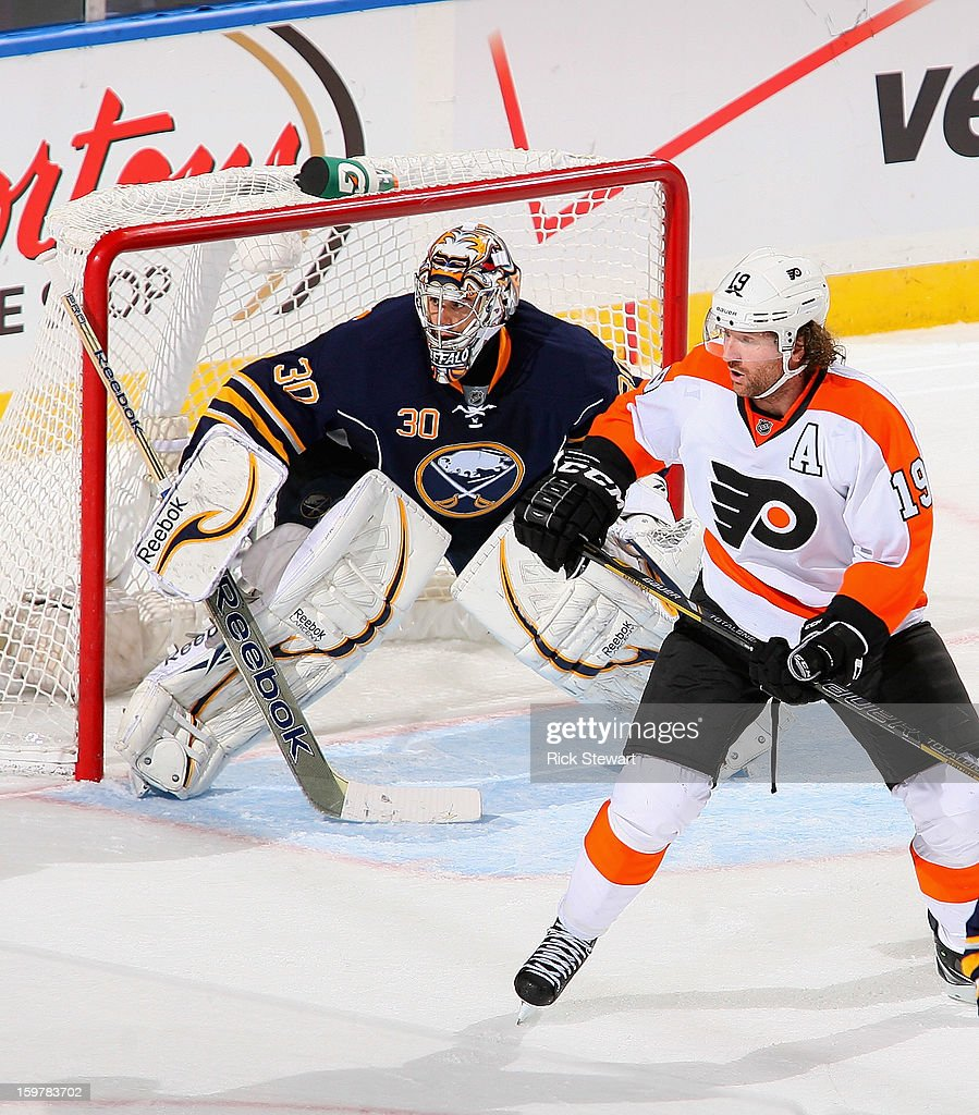 Ryan Miller #30 of the Buffalo Sabres defends behind Scott Hartnell #19 of the Philadelphia Flyers at First Niagara Center on January 20, 2013 in Buffalo, United States. Buffalo won 5-2.