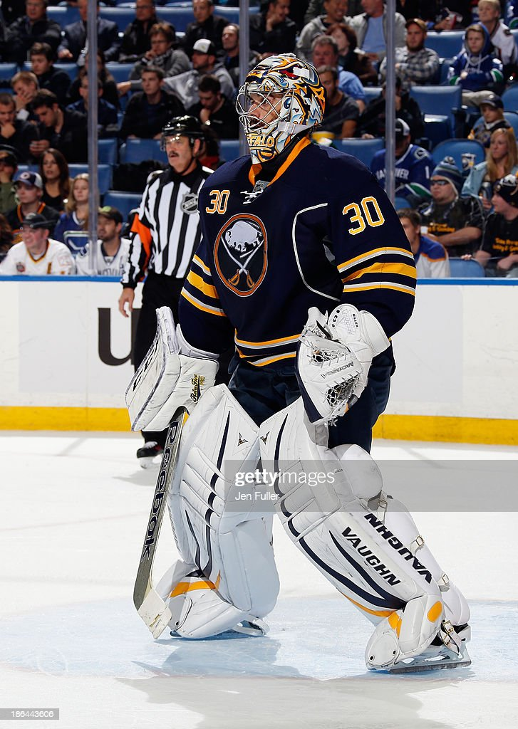 Ryan Miller #30 of the Buffalo Sabres defends the net against the Vancouver Canucks at First Niagara Center on October 17, 2013 in Buffalo, New York.