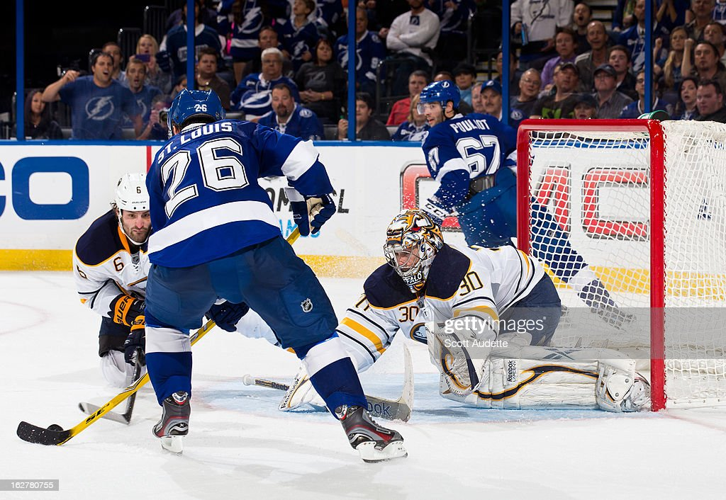 Ryan Miller #30 of the Buffalo Sabres dives to block a shot by <a gi-track='captionPersonalityLinkClicked' href=/galleries/search?phrase=Martin+St.+Louis&family=editorial&specificpeople=202067 ng-click='$event.stopPropagation()'>Martin St. Louis</a> #26 of the Tampa Bay Lightning during the third period of the game at the Tampa Bay Times Forum on February 26, 2013 in Tampa, Florida.