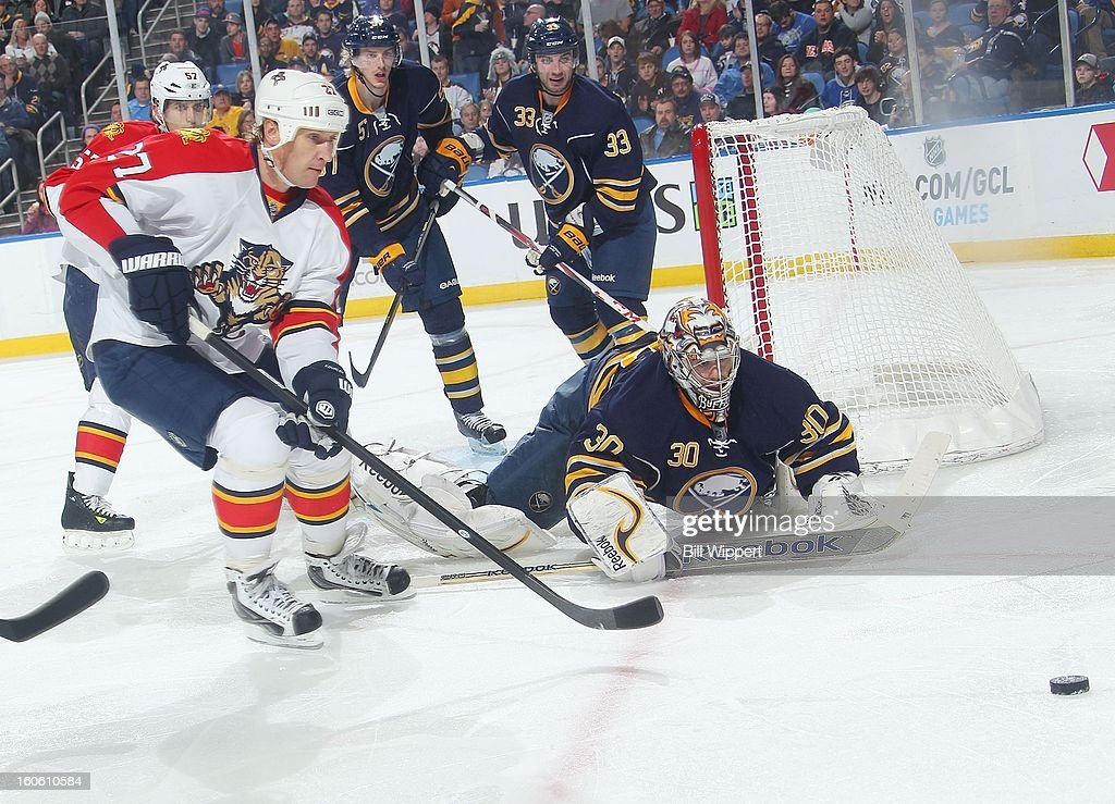 Ryan Miller #30 of the Buffalo Sabres dives to deflect the puck away from Alex Kovalev #27 of the Florida Panthers on February 3, 2013 at the First Niagara Center in Buffalo, New York.