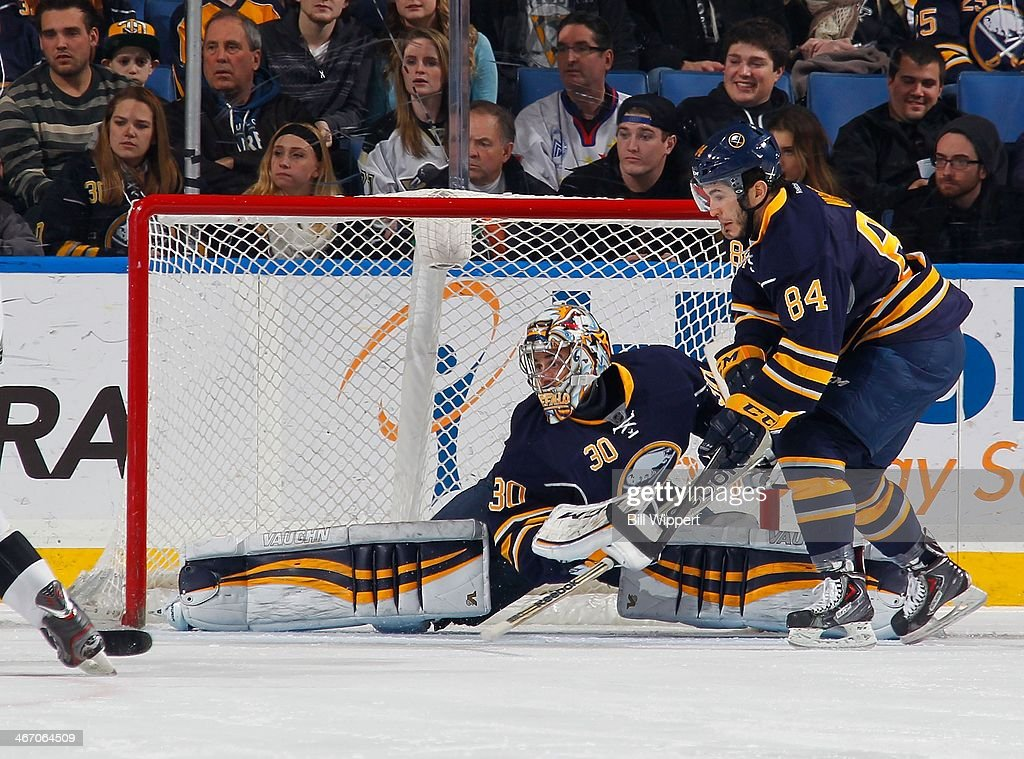 Ryan Miller #30 of the Buffalo Sabres does a split to make a save against the Pittsburgh Penguins on February 5, 2014 at the First Niagara Center in Buffalo, New York. Pittsburgh won, 5-1.