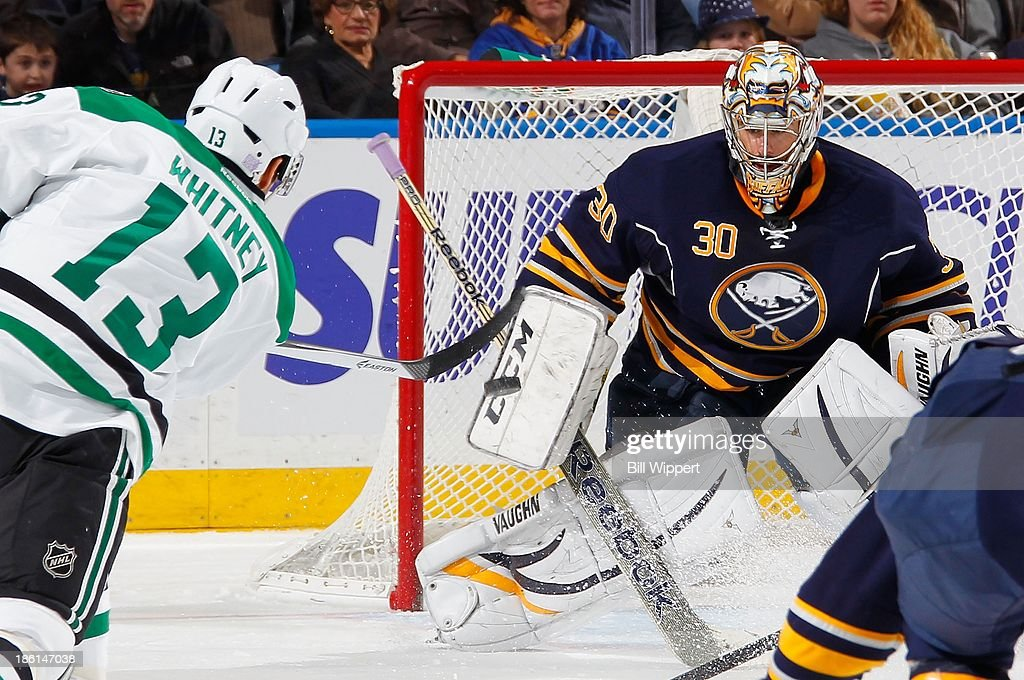 Ryan Miller #30 of the Buffalo Sabres focuses in on the puck after <a gi-track='captionPersonalityLinkClicked' href=/galleries/search?phrase=Ray+Whitney&family=editorial&specificpeople=202090 ng-click='$event.stopPropagation()'>Ray Whitney</a> #13 of the Dallas Stars fires a second period shot on October 28, 2013 at the First Niagara Center in Buffalo, New York.