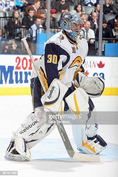 Ryan Miller of the Buffalo Sabres guards the net against the Toronto Maple Leafs during their NHL game at the Air Canada Centre on April 8 2009 in...