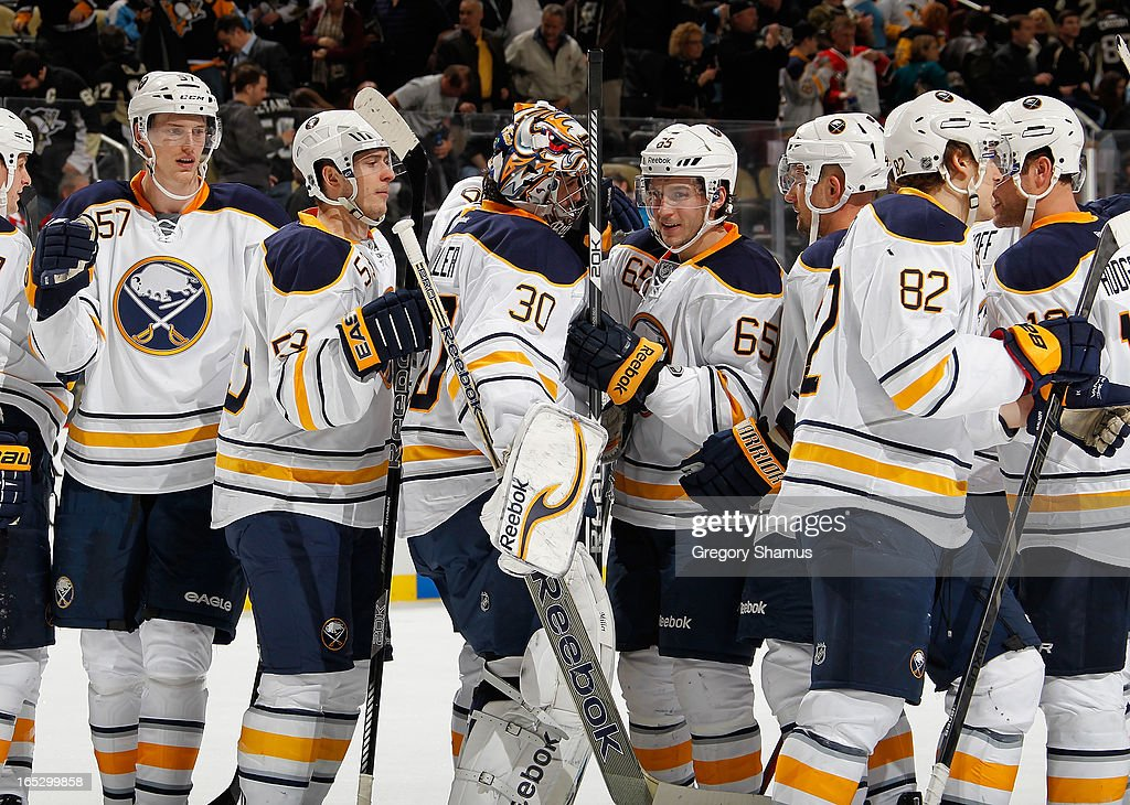 Ryan Miller #30 of the Buffalo Sabres is congratulated by teammates after a 4-1 win against the Pittsburgh Penguins on April 2, 2013 at Consol Energy Center in Pittsburgh, Pennsylvania.
