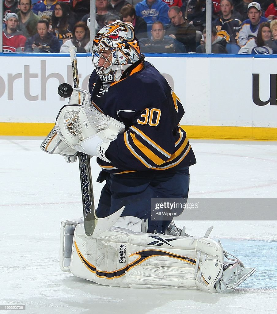 Ryan Miller #30 of the Buffalo Sabres juggles the puck on a second-period save against the Montreal Canadiens on April 11, 2013 at the First Niagara Center in Buffalo, New York.