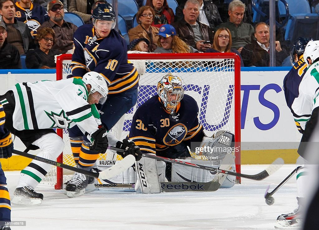 Ryan Miller #30 of the Buffalo Sabres keeps an eye on a loose puck as teammate <a gi-track='captionPersonalityLinkClicked' href=/galleries/search?phrase=Christian+Ehrhoff&family=editorial&specificpeople=214788 ng-click='$event.stopPropagation()'>Christian Ehrhoff</a> #10 defends <a gi-track='captionPersonalityLinkClicked' href=/galleries/search?phrase=Erik+Cole&family=editorial&specificpeople=204754 ng-click='$event.stopPropagation()'>Erik Cole</a> #72 of the Dallas Stars on October 28, 2013 at the First Niagara Center in Buffalo, New York.